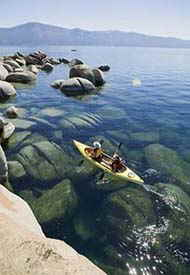 kayaking at south lake tahoe directly across  from  Lake Village Vacation Rentals